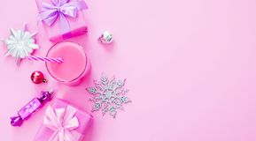 Banner Decorative background Christmas composition Flat lay box gift ribbon bow snowflake cocktail pink. Top view copy space stock photography