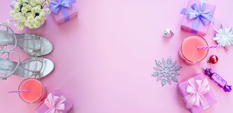 Banner Decorative background Christmas composition Flat lay box gift ribbon bow snowflake cocktail pink. Top view copy space stock image