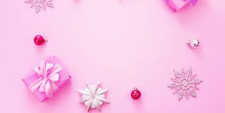 Banner Decorative background Christmas composition Flat lay box gift ribbon bow snowflake cocktail pink. Top view copy space stock photo