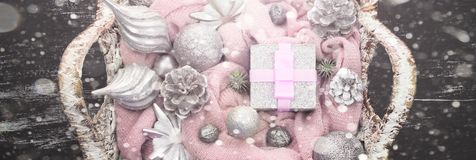 Banner Decorative Christmas composition Christmas toys in the basket. stock photos