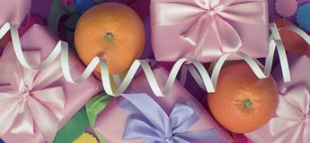 Banner Decorative composition five boxes with gifts Satin ribbon Bow Oranges Confetti Serpentine birthday party. The view from the top royalty free stock photo