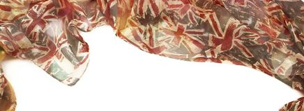 Banner Decorative draping frame of the textile. Women`s scarf red figure the British flag. White background top view Stock Photography