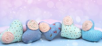 Banner Decorative textile heart handmade. Blue background View from above the Concept of Valentine`s day Flat lay Royalty Free Stock Photo