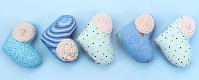 Banner Decorative textile heart handmade. Blue background View from above the Concept of Valentine`s day Flat lay Stock Photo