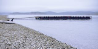 Banner Defocus Sea landscape hills horizon sky fog nature wooden pier . Banner Defocus Sea landscape hills horizon sky fog nature wooden pier. Natural royalty free stock photography