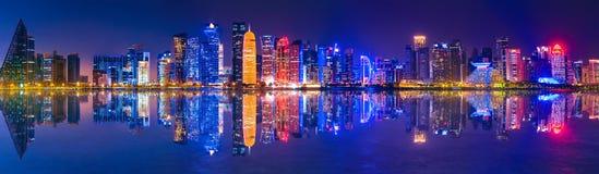 Banner Doha skyline night. Banner of capital city of Qatar by night. Doha West Bay skyline mirroring in Doha Bay. Panorama of glassed skyscrapers of Doha, Qatar stock photography