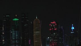 Banner Doha skyline night. Capital city of Qatar by night. Doha West Bay skyline in Doha Bay. Panorama of glassed skyscrapers of Doha, Qatar, Middle East stock video footage