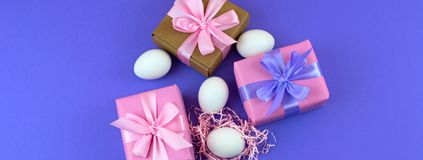 Banner Easter gift Box set and white eggs. The view from the top Place for text. Background ultraviolet Royalty Free Stock Photography