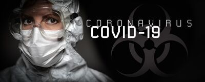 Banner of Female Doctor or Nurse In Medical Face Mask and Protective Gear With Coronavirus COVID-19 Text