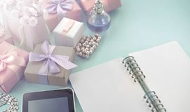 Banner Festive background poster box gift satin ribbon bow bouquet of flowers jewelry pearl notebook tablet smartphone background. Blue. Top view copy space royalty free stock images
