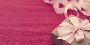 Banner Festive composition three Kraft boxes with gifts on bright pink background. royalty free stock images