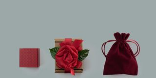 Banner Festive gift packaging red ribbon box gray background Concept Valentine& x27;s day, women& x27;s day. Banner Festive gift packaging red ribbon box gray stock photo