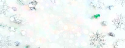 Banner Festive holiday background with light delicate bokeh effect and drawing Decorative snow. Copy space for text happy New year or Christmas Winter greeting Stock Photography