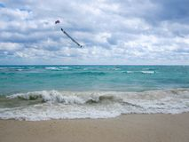 Banner in the sky over caribbean sea in a cloudy day. Banner flying  in the sky over caribbean sea in a cloudy day Royalty Free Stock Photos