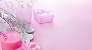 Banner Gift box with satin ribbon bow for women Flowers Buy Shoes a Glass of Cocktail. Set of festive items flat lay top view stock image