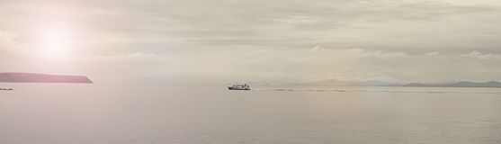 Banner Gloomy seascape line horizon the ship is coming. stock photos