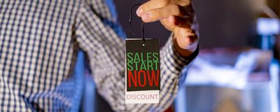 Banner of hand holding a price tage with sale concept f royalty free stock photo