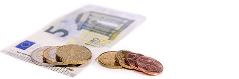 Banner or header, euro currency on white, new minimum wage in ge. Banner or header, european currency on white, new minimum wage in germany is 8,84 euro Stock Photo