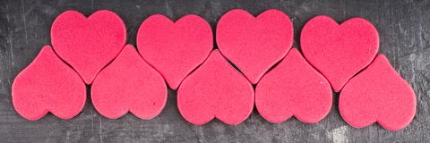 Banner. hearts on grey background. Red and pink hearts on grey background stock image