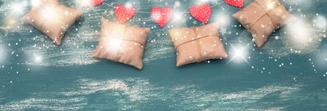 Banner holiday gifts garland on a blue vintage background. royalty free stock images