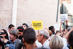 Banner at immigrants march in rome asking for hospitality for refugees Rome, Italy, 11 September 2015. Banner at migrants march in rome royalty free stock image