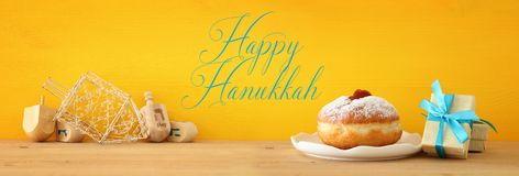 Banner of jewish holiday Hanukkah with wooden dreidels & x28;spinning top. Banner of jewish holiday Hanukkah with wooden dreidels & x28;spinning top stock images