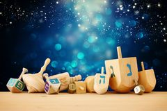 Banner of jewish holiday Hanukkah with wooden dreidels & x28;spinning top& x29; over glitter shiny background. Banner of jewish holiday Hanukkah with wooden stock photo