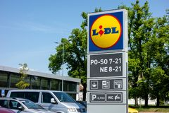 The banner of the Lidl supermarket of the second generation in Hlucin showing the offered services royalty free stock photography