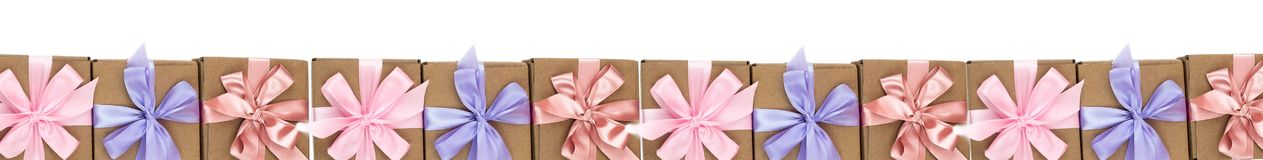 Banner lot of holiday boxes with gifts tied with satin ribbon on a white background. The view from the top Flat layer stock photo