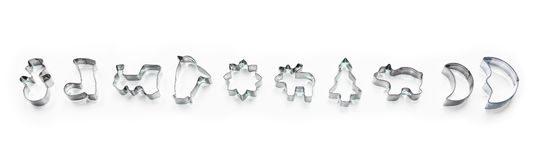 Banner made of shiny christmas silver biscuit shapes, cookie cutter isolated on white background with shadows