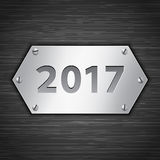 2017 banner. 2017 metallic banner attached with screws on dark brushed metallic background. Vector illustration Royalty Free Stock Photography
