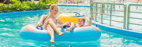 BANNER Mom and son have fun at the water park long format. BANNER Mom and son have fun at the water park. long format stock image