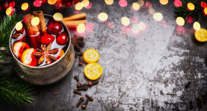 Banner with mulled wine cup and spices on dark rustic background Stock Image