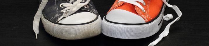 Banner of new orange and old blue sneakers stock images