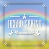 Banner, poster for design. Hi spring. Welcome. Against the background of a blurry sky, a green lawn, and a rainbow. In frame. 10 eps Stock Photography