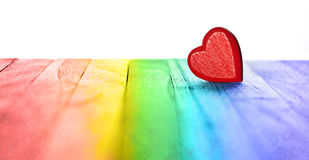 Banner Rainbow Love Heart Background. A red love heart on a rainbow wood background Stock Images