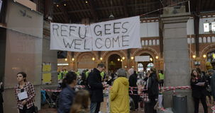 Banner Refugees Welcome Hanged by Charity stock video footage