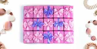 Banner Rows of boxes with gifts decoration ribbon satin bow pink fashion accessories for women jewelry pearl necklace bracelet A t. Banner Rows of boxes with stock image
