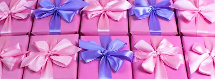Banner Rows of boxes with gifts decoration ribbon satin bow pink A top view of Flat lay. Banner Rows of boxes with gifts decoration ribbon satin bow pink. A top royalty free stock photos