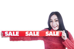 Banner of sale hold by girl isolated in white Royalty Free Stock Photography