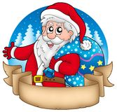 Banner with Santa holding gifts Stock Photo