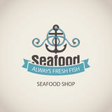 Banner for seafood with an anchor, rope and words. Vector emblem or banner for seafood shop with an anchor, rope and words always fresh fish on the beige Royalty Free Stock Image