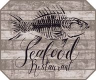 Banner for seafood restaurant with picture of fish Stock Photography