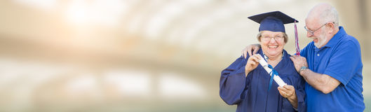 Banner of Senior Adult Woman Graduate In Cap and Gown Being Cong Stock Photography