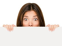 Banner sign woman peeking over edge royalty free stock images