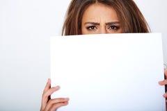 Banner sign woman peeking over edge of blank empty Stock Image
