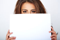 Banner sign woman peeking over edge of blank empty Stock Photos
