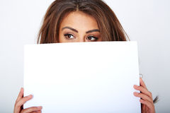 Banner sign woman peeking over edge of blank empty Stock Images