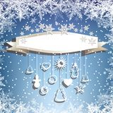 Banner, snowflakes and hanging toys on the blue background. Royalty Free Stock Images