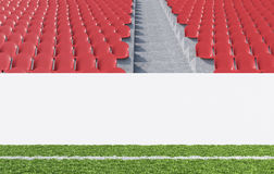 Banner at stadium. Blank banner around pitch, red seats, aisle between them. Front view. Concept of sport advertising. Mock up. 3D rendering Stock Photo